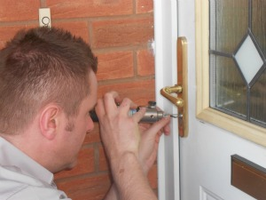 Locksmith gaining entry to a customer's property